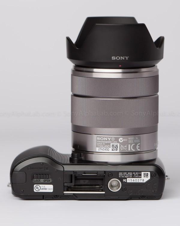 Sony Nex-C3 with 18-55mm lens - Memory card door open