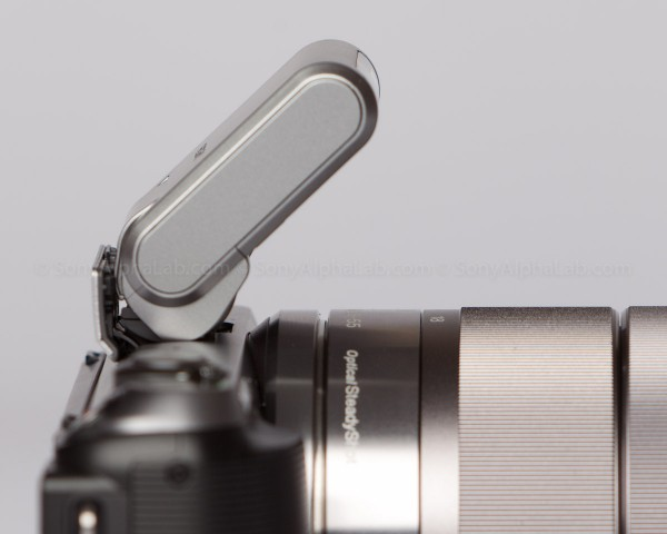 Sony Nex-C3 - 18-55mm zoom lens - Flash attached - side view