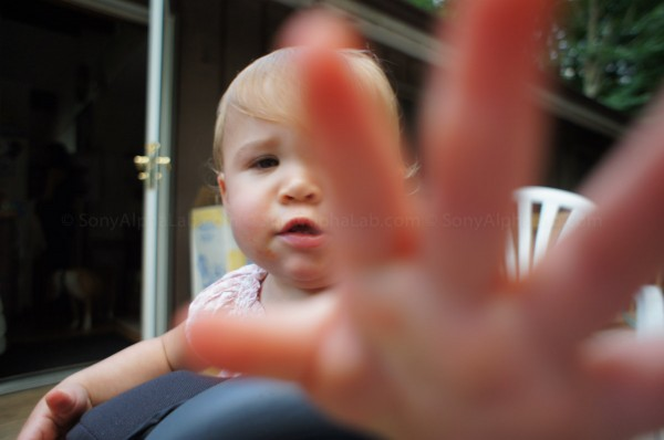 Layla Grabbing for the Camera - Sony Nex-C3, Sony 16mm f/2.8 Lens @ f/2.8, 1/100sec, ISO 200, skin smoothing option on High