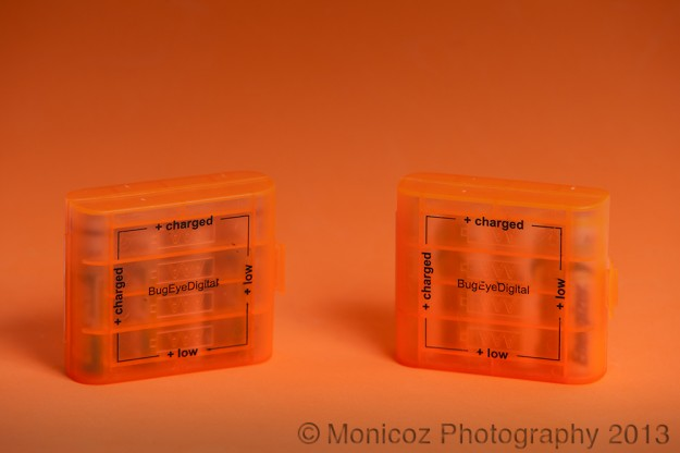 Orange battery holders on an orange background