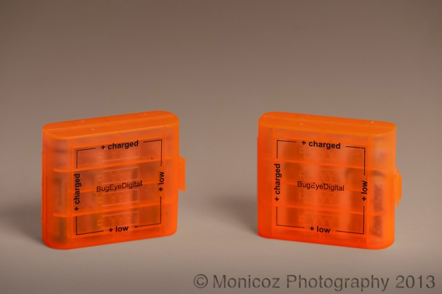 orange battery holders on a white background