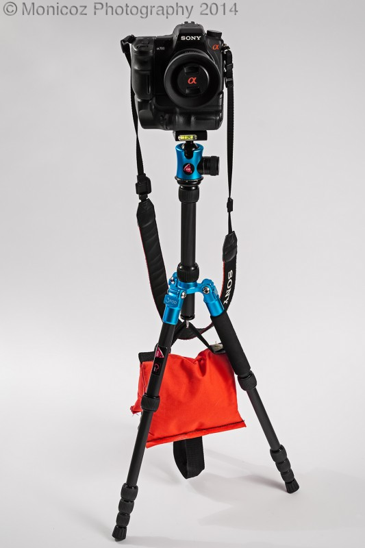 attaching a sandbag to a tripod